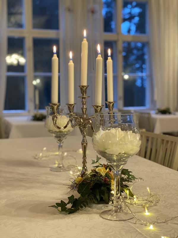 Urpolan Kartano sali sisustus kynttilä
